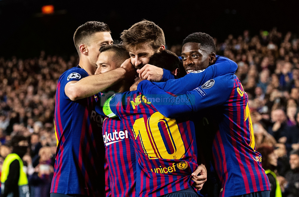 BARCELONA, March 14, 2019  Barcelona's Gerard Pique (C) celebrates after scoring during the UEFA Champions League match between Spanish team FC Barcelona and French team Lyon in Barcelona, Spain, on March 13, 2019. Barcelona won 5-1 and advanced to the quarterfinals. (Credit Image: © Joan Gosa/Xinhua via ZUMA Wire)