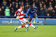 AFC Wimbledon defender Paul Osew (37) battles for possession with Doncaster Rovers defender Brad Halliday (2) during the The FA Cup match between AFC Wimbledon and Doncaster Rovers at the Cherry Red Records Stadium, Kingston, England on 9 November 2019.