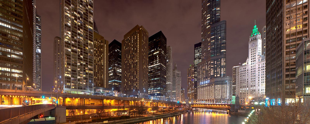 An evening photograph taken during the waning days of winter on the Chicago River facing west toward Michigan Avenue and the Trump Tower. Exterior Architectural Photography. Buildings, locations, architecture. Chicago, Illinois, built landscape,