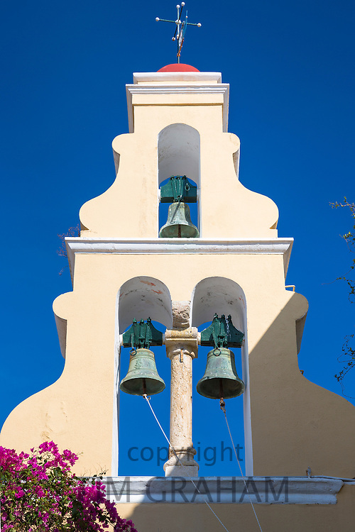 ARIPaleokastritsa Monastery, 13th Century with bells in belltower portico and bougainvillea in Corfu, , Greece