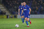 AFC Wimbledon defender Luke O'Neill (2) dribbling during the The FA Cup match between AFC Wimbledon and Doncaster Rovers at the Cherry Red Records Stadium, Kingston, England on 9 November 2019.