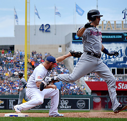 July 2, 2017 - Kansas City, MO, USA - Minnesota Twins' Joe Mauer beats out the double play throw to Kansas City Royals first baseman Brandon Moss after Robbie Grossman was forced out at second in the fifth inning on Sunday, July 2, 2017 at Kauffman Stadium in Kansas City, Mo. (Credit Image: © John Sleezer/TNS via ZUMA Wire)