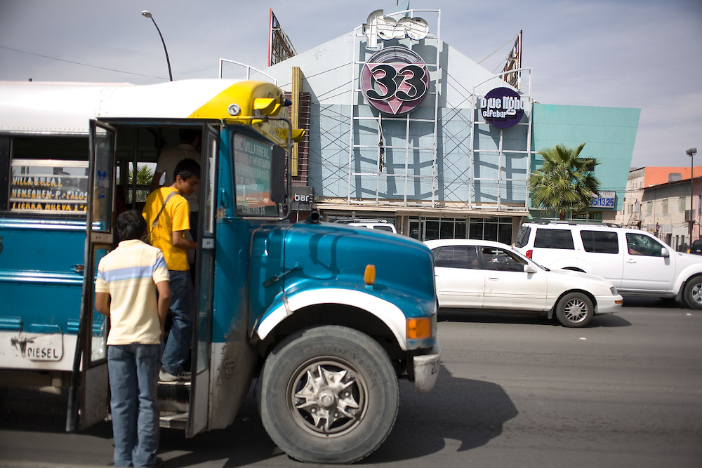 """.Locals climb aboard a bus in front of the old """"Live 33"""" in Juarez Mexico on Saturday, Oct. 10, 2009.."""