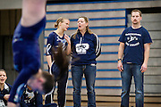 Champlin Park captain Amanda Cunningham converses with assistant coach Cindi Cain as head coach Jon Wynia, right, looks on during the dual gymnastics meet against Coon Rapids High School at Champlin Park, Friday, January 31, 2014. Champlin Park won the meet with a combined score of 137.35 over Coon Rapids' 125.975.
