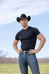 muscular cowboy outdoors