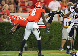 September 16, 2017 - Athens, GA, USA - Georgia wide receiver Terry Godwin soars into the end zone over Samford defensive back Omari Williams for a touchdown and a 21-0 lead, with teammate Riley Ridley (8) looking, on during the second quarter on Saturday, Sept. 16, 2017, at Sanford Stadium in Athens, Ga. (Credit Image: © Curtis Compton/TNS via ZUMA Wire)