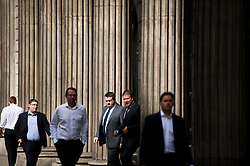 © London News Pictures. 01/07/2013. London, UK. General view of office workers outside the Bank of England in central London on July 01, 2013. The Bank of England is due to release the Money and Credit report for May. Photo credit: Ben Cawthra/LNP