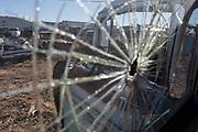 "Broken glass in the ""bone yard"" behind Bozo's Garage in Santa Rosa New Mexico. - Steven St. John for New Mexico Magazine"
