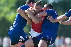 June 16, 2018 - Ottawa, ON, U.S. - OTTAWA, ON - JUNE 16: Nick Blevins (12 Centre ) of Canada is tied up by two Russian players in the Canada versus Russia international Rugby Union action on June 16, 2018, at Twin Elms Rugby Park in Ottawa, Canada. Russia won the game 43-20. (Photo by Sean Burges/Icon Sportswire) (Credit Image: © Sean Burges/Icon SMI via ZUMA Press)