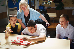 Pupils playing a game in a special school for physical disabilities