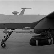 """Sep 17, 2009 - Kandahar, Kandahar Province, Afghanistan - A US Air Force Reaper (Drone) which is an unmanned aerial vehicle (UAV)seen in a secret location at an air base in Kandahar Province, Afghanistan loaded with Hellfire missiles and guided 500 lb bombs. The Reaper is a hunter-killer UAV and is a larger and newer aircraft than it's predecessor known as a Predator. These aircraft are frequently used to cover Canadian Operations in Kandahar.Years ago this aircraft was originally used for surveillance and eventually was designed to carry weapons systems as it does now. This frequently used aircraft has become a major part of the strategy to destroy militants around Afghanistan and the border regions of Pakistan.  Reporters often refer to these aircraft as """"Drones""""..(Credit Image: © Louie Palu/ZUMA Press)."""
