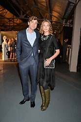 ARIZONA MUSE and ALIAS ABEGG at the Women for Women International Catwalk Show & Auction in partnership with Brown's and sponsored by Swarovski held at The Vinyl Factory, Brewer Street Space, Brewer Street, London on 20th November 2014.