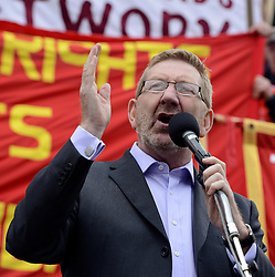 """© Licensed to London News Pictures. File pic dated 01/05/2012. London, UK . Len McCluskey, the General Secretary of the British and Irish union Unite speaking at a May Day march in Trafalgar Square. Len McCluskey has threatened to withdraw funding from the Labour Party if the  """"correct leader"""" isn't chosen. . Photo credit : Stephen Simpson/LNP"""