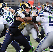 Football - NFL- Seattle Seahawks at St. Louis Rams.St. Louis Rams wide receiver Brian Quick (83) tangles with Seattle Seahawks outside linebacker K.J. Wright (50) in the third quarter at the Edward Jones Dome in St. Louis.  The Rams defeated the Seahawks, 19-13.