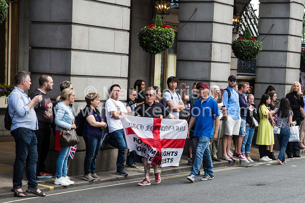 London, UK. 10th June, 2018. Members of a far-right group prepare to taunt hundreds of people taking part in the pro-Palestinian Al Quds Day march through central London organised by the Islamic Human Rights Commission. An international event, it began in Iran in 1979. Quds is the Arabic name for Jerusalem.