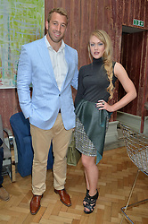 CHRIS ROBSHAW captain of England Rugby and CAMILLA KERSLAKE at a cocktail reception to celebrate the launch of the Bicester Village the British Designer's Collective 2014 held at the The Keeper's House, Royal Academy of Art, Piccadilly, London on 20th May 2014.