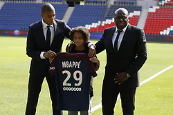 PSG's new player Kylian Mbappe is unveiled alongside Paris Saint Germain president Nasser Al-Khelaifi during a press conference at the Parc des Princes, following his transfer from Monaco FC to Paris Saint Germain, France, on September 6, 2017. The 18-year-old Mbappé, who was born in Paris, will initially make the move to PSG from French champions Monaco on a one-year loan before signing a permanent deal. Photo by Henri Szwarc/ABACAPRESS.COM