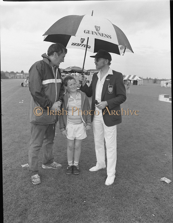 "Guinness Family Day At The Iveagh Gardens. (R83)..1988..02.07.1988..07.02.1988..2nd  July 1988..The family fun day for Guinness employees and their families took place at the Iveagh Gardens today. Top at the bill at the event were ""The Dubliners"" who treated the crowd to a performance of all their hits. Ireland's penalty hero from Euro 88, Packie Bonner, was on hand to sign autographs for the fans...Peter the sports compere is pictured  discussing the days events with one of the sports organisers and his son."