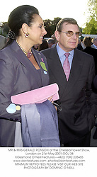 MR & MRS GERALD RONSON at the Chelsea Flower Show, London on 21st May 2001.OOJ 38