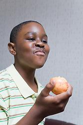 Teenage boy eating an apple,
