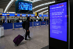 © Licensed to London News Pictures. 09/09/2019. London, UK. A man passes the information board at Heathrow Terminal 5 departures which is completely empty as tens of thousands of British Airways passengers face disruption on the first day of the two days first-ever strike staged by British Airways pilots dispute over pay. British Airways had requested its passengers that they were unlikely to travel and to make alternative arrangements prior to the strike action. Photo credit: Dinendra Haria/LNP