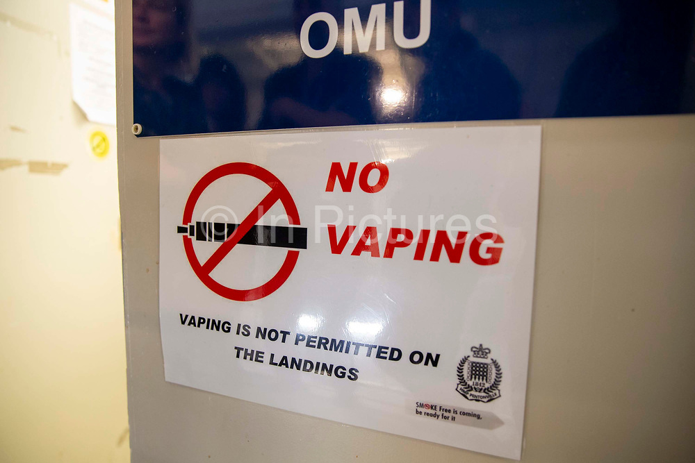 No Vaping Sign on the door of the OMU, Offender Management Unit, in Her Majesty's Prison Pentonville, London, United Kingdom. Vaping is not allowed in the landings outside the cells.