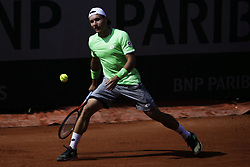 May 21, 2019 - Paris, France - Lucas Miedler of Austria in action against Evgeny Karlovsky of Russia in the first round of Roland Garros qualifications in Paris, France, on 21 May 2019. (Credit Image: © Ibrahim Ezzat/NurPhoto via ZUMA Press)