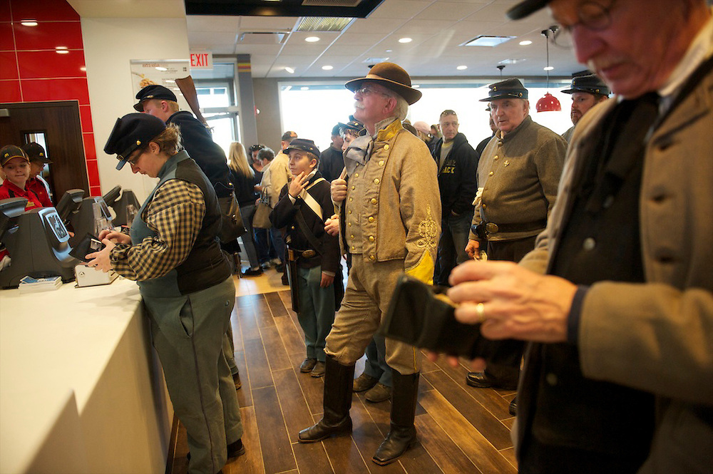 Confederate soldiers wait in line at McDonald's following a Remembrance Day Parade, celebrating the 149th anniversary of the Gettysburg Address, on November 17, 2012 in Gettysburg, PA.