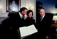A presentation of a book from the Laymen's National Bible Committee to Rosalynn Carter at the Diplomatic entrance room of the White House,<br /> Photo by Dennis Brack