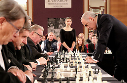ZAGREB, Dec. 30, 2017 Russian chess grandmaster and former world champion Garry Kasparov plays against former Speaker of Croatian Parliament Vladimir Seks(4th L) during a simultaneous chess exhibition match in Zagreb, Croatia, on Dec. 29, 2017. (Credit Image: © Relja Dusek/Xinhua via ZUMA Wire)