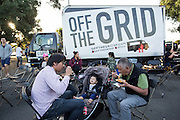 Families eat numerous cuisines from half a dozen food trucks during Off the Grid at the Great Mall of the Bay Area in Milpitas, California, on May 12, 2016. (Stan Olszewski/SOSKIphoto)