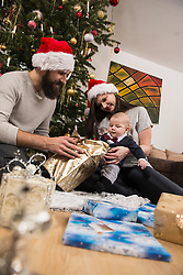 Parents with baby holding gift