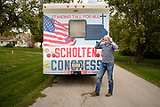"""03 OCTOBER 2020 - NEW PROVIDENCE, IOWA: J.D. SCHOLTEN talks to voters during a socially distanced campaign stop in New Providence, a small community in central Iowa. Scholten, and everybody else there, also wore face masks in accordance with CDC guidelines to prevent the spread of COVID-19. Scholten, a Democrat from Sioux City, Iowa, ran against incumbent CongressmanSteve King (R-4th District Iowa) in 2018 and came within a few percentage points of upsetting the long serving conservative. King lost to Randy Feenstra, a Republican challenger, in the 2020 primary and Scholten is running against Feenstra in the 2020 general election on November 3. Iowa's 4th district, centered in the agricultural and sparsely populated northwest corner of the state, is the largest congressional district in Iowa and encompasses about ⅓ of the state of Iowa. Scholten is on his """"Every Town Tour 2020."""" He is visiting all 375 towns in the 39 counties in the district.           PHOTO BY JACK KURTZ"""