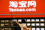 A show employee work on the Taobao.com exhibition at the ChinaJoy Expo, the annual online gaming expo, in Shanghai, China on 30 July, 2011.   China is now the world's largest online gaming market, contributing one-third to the global revenue in this sector in 2009, or 56 percent of the Asia Pacific total. Taobao is China's biggest online retail site.