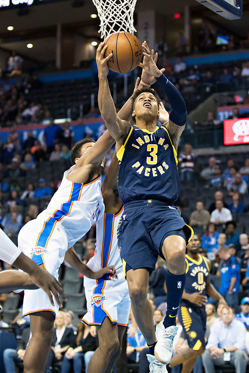 OKLAHOMA CITY, OK - OCTOBER 25:  Joe Young #3 of the Indiana Pacers goes up for a reverse layup during a game against the Oklahoma City Thunder at the Chesapeake Energy Arena on October 25, 2017 in Oklahoma City, Oklahoma.  NOTE TO USER: User expressly acknowledges and agrees that, by downloading and or using this photograph, User is consenting to the terms and conditions of the Getty Images License Agreement.  The Thunder defeated the Pacers 114-96.  (Photo by Wesley Hitt/Getty Images) *** Local Caption *** Joe Young