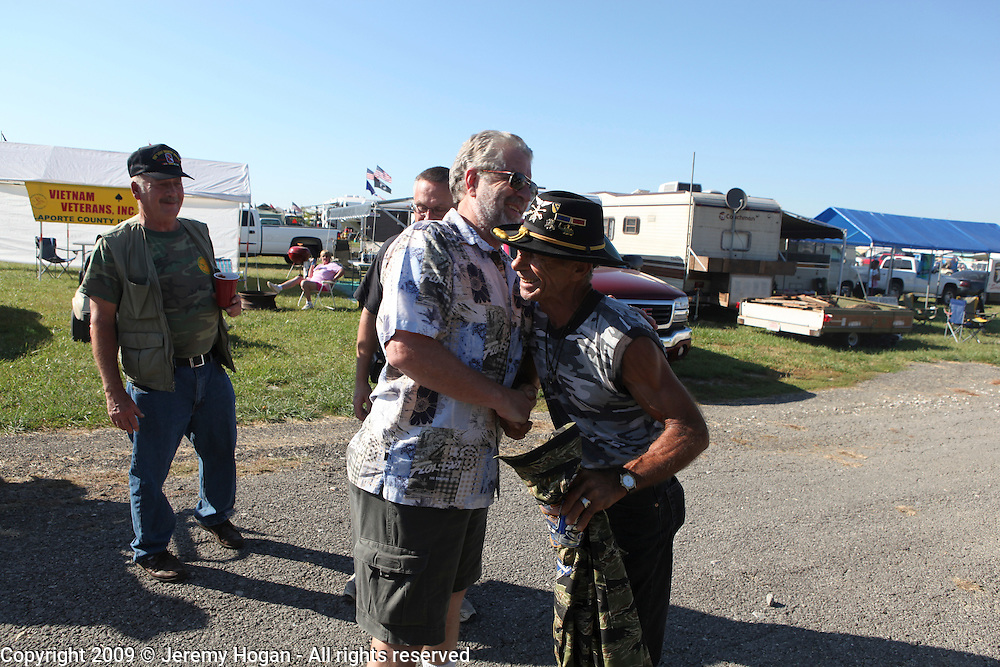 Jerry Hogan, B Troop, 1/9th Cavalry, right, greets Phil Zook who was a Lt. in the 1st of the 7th Cavalry. Hogan and Zook served in the same army division during the 1970 Cambodia incursion. Vietnam Veterans gather in Kokomo, Indiana for the 2009 reunion.