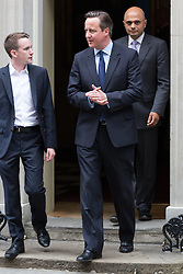 © Licensed to London News Pictures. 23/06/2015. London, UK. DAVID CAMERON and SAJID JAVID leaving Downing Street at the launch of the Start-Up Britain campaign routemaster bus in Downing Street, London with Prime Minister, David Cameron. Over five weeks the routemaster bus will visit 30 towns and cities - including Aberdeen, Inverness, Swansea York and Leeds - and aim to engage with 15,000 individuals through workshops and networking events, making them aware of the assistance Start-Up Britain can offer. Photo credit : Vickie Flores/LNP
