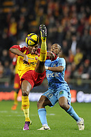 FOOTBALL - FRENCH CHAMPIONSHIP 2010/2011 - L1 - RC LENS v OLYMPIQUE MARSEILLE - 3/04/2011 - PHOTO JEAN MARIE HERVIO / DPPI - ALASSANE TOURE (RCL) / ANDRE AYEW (OM)