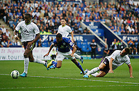 Everton's Sylvain Distin (L) and Phil Jagielka (R) in action with Leicester City's Riyad Mahrez<br /> <br /> Photographer Jack Phillips/CameraSport<br /> <br /> Football - Barclays Premiership - Leicester City v Everton - Saturday 16th August 2014 - King Power Stadium - Leicester<br /> <br /> © CameraSport - 43 Linden Ave. Countesthorpe. Leicester. England. LE8 5PG - Tel: +44 (0) 116 277 4147 - admin@camerasport.com - www.camerasport.com