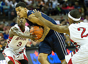 Keith Frazier (2) of Dallas Kimball drives through the Rosenberg Terry defense during the UIL 4A state championship game at the Frank Erwin Center in Austin on Saturday, March 9, 2013. (Cooper Neill/The Dallas Morning News)