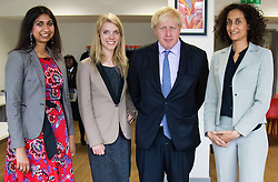Michaela Community School, Wembley, London, June 23rd 2015. Mayor of London Boris Johnson visits the Michaela Community School, a Free School in Wembley that started taking students in September2014 after battling a certain amount of resistance from locals and unions. During the visit Head Teacher Katharine Birbalsingh took the Mayor on a tour of the school before he participated in a history lesson, prior to sitting down with pupils for brunch. PICTURED: Mayor of London Boris Johnson poses for a picture with MP Suella Fernandez (L) and Head Teacher Katharine Birbalsingh (R)