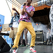 WASHINGTON, DC - August 11th, 2012 - Tabi Bonney (right) performs backed by Beat Ya Feet Kingz at the inaugural Trillectro Festival at the Half Street Fairgrounds in Washington, D.C. The festival was a combination of hip-hop and dance acts, bringing together fans of both genres.  (Photo by Kyle Gustafson/For The Washington Post)
