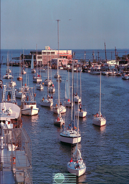 1980 Clear Creek Channel with sail boats waiting for the draw bridge to open in Kemah and Seabrook, Texas waterfront.