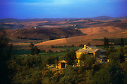 A small estate sits on the top of rolling hills in Tuscany, Italy