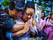 13 OCTOBER 2016 - BANGKOK, THAILAND:  People at Siriraj Hospital cry and comfort each other Thursday afternoon after Bhumibol Adulyadej, the King of Thailand, died. Thousands of people came to the hospital to pray for the beloved monarch. Bhumibol Adulyadej, the King of Thailand, died at Siriraj Hospital in Bangkok Wednesday, October 13, 2016. Bhumibol Adulyadej, 5 December 1927 – 13 October 2016, was the ninth monarch of Thailand from the Chakri Dynasty and is known as Rama IX. He became King on June 9, 1946 and served as King of Thailand for 70 years, 126 days. He was, at the time of his death, the world's longest-serving head of state and the longest-reigning monarch in Thai history.      PHOTO BY JACK KURTZ