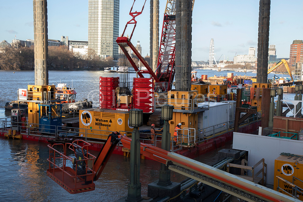 Construction work underway on the Thames Tideway Tunnel or Super Sewer alongside Vauxhall Bridge on the River Thames in London, England, United Kingdom. The Thames Tideway Tunnel is an under-construction civil engineering project 25 km tunnel running mostly under the tidal section of the River Thames through central London, which will provide capture, storage and conveyance of almost all the combined raw sewage and rainwater discharges that currently overflow into the river.