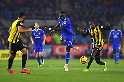 Cardiff City's Oumar Niasse (centre) and Watford's Abdoulaye Doucoure battle for the ball during the Premier League match at the Cardiff City Stadium.