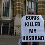 Protestors holding a banner written (Boris Killed My Husband) are calling for justice for the victims of COVID-19 who lost their lives because the UK government failed to contain the Indian variant nation, continues by allowing spread outside Downing Street, 7 July 2021, London, UK.