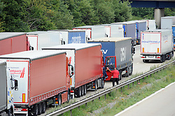© Licensed to London News Pictures. 30/07/2015 <br /> Operation Stack Lorries on the M20 in Ashford near Junction 9.<br /> <br /> Traffic misery continues on the M20 with Operation Stack and will most likely remain in place into the weekend.<br /> A 23-mile stretch of the coast-bound carriageway is shut with part of the London-bound side also closed.<br /> <br /> <br /> (Byline:Grant Falvey/LNP)