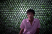CHONGQING, CHINA - (CHINA OUT) <br /> <br /> Over Eight Thousand Beer bottles To Make A House<br /> <br /> A villager asks Li Rongjun (L), a graduate in Architecture Department from Inner Mongolia University Of Science & Technology, about his self-made 29-squaremeter beer-bottle house at Qijiang District on June 26, 2015 in Chongqing, China. When all graduates planed to hunt for work in market, Li Rongjun from south China\'s Chongqing, dreamed to realize his idea - Architecture works. According to Li Rongjun, beer-bottle house was his model house which could be used as office room with artistry. He dreamed to creat new ideas on architecture and then put them into practice, such as the 29-squaremeter beer-bottle house on second floor which he made with more than eight thousand beer bottles together with father after returning home. The beer-bottle house cost totaly 70,000 RMB (about 11.270 USD), said Li Rongjun\'s father Li Xianshui. <br /> ©Exclusivepix Media